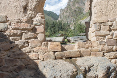 Photo of a Natural Spring and Mountains in Ollantaytambo Fortress in the Sacred Valley, Peru