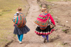 Photo of Inca Women walking down the trail from Rainbow Mountain