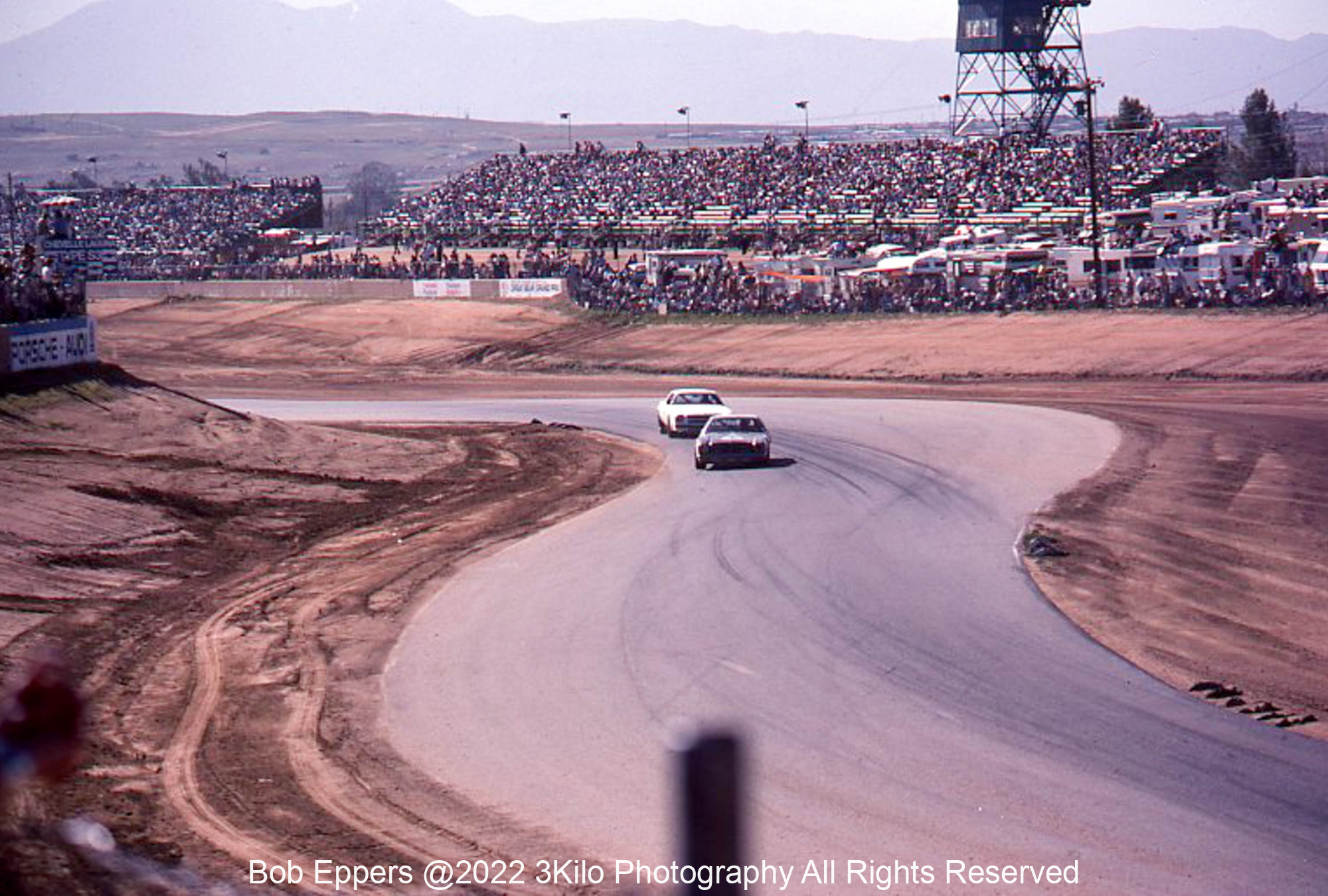 Photo of a NASCAR race at Riverside, CA.  Coming up the esses.
