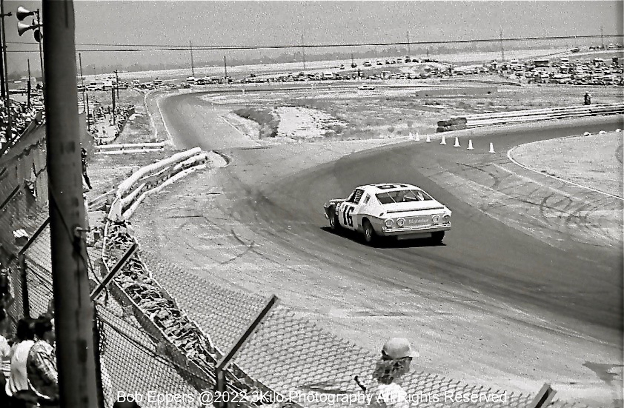 Photo of Bobby Allison exiting Turn 6 at a NASCAR Race at Riverside.