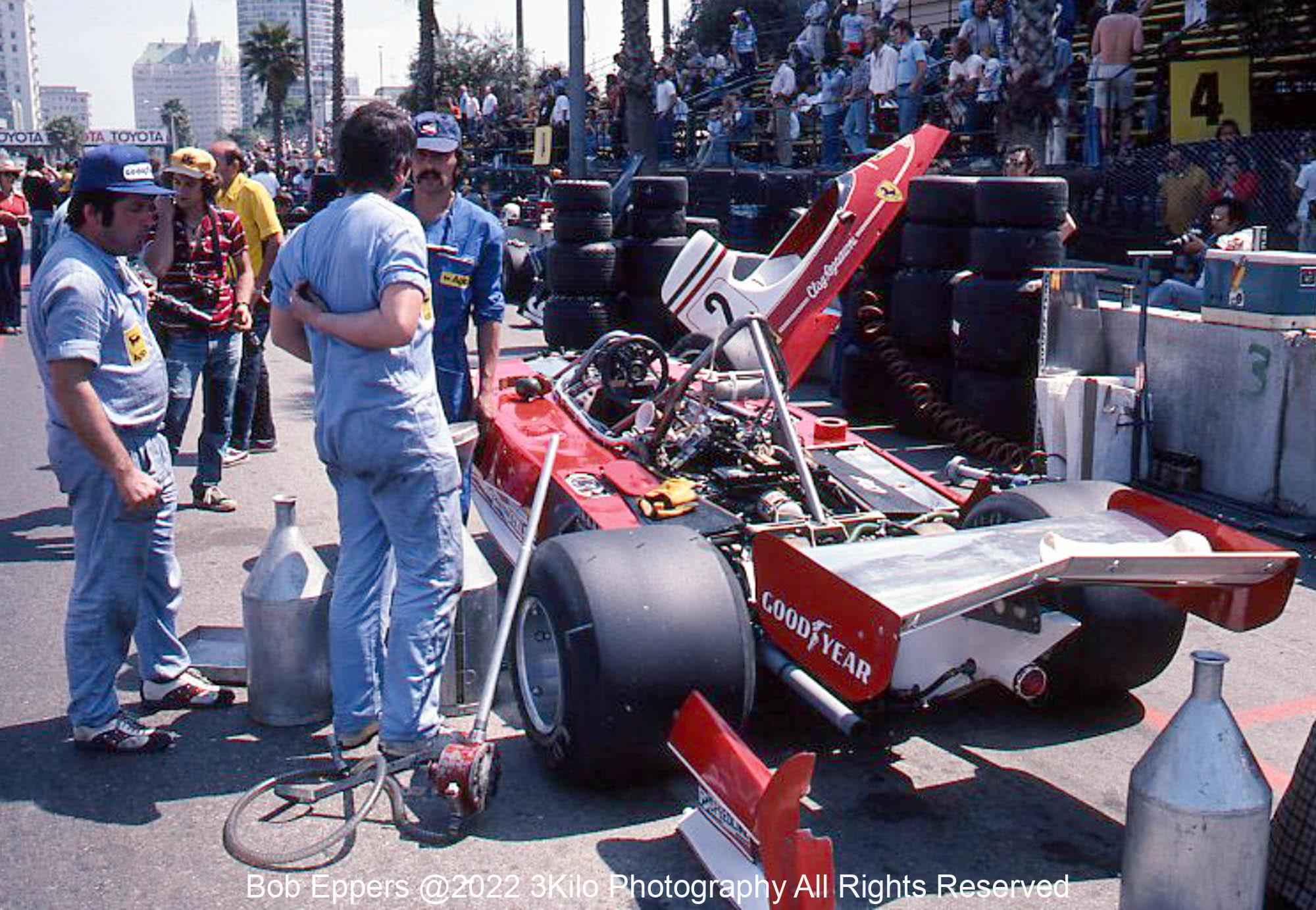 Photo of F1 Ferrari and mechanics in the pit lane.  1976