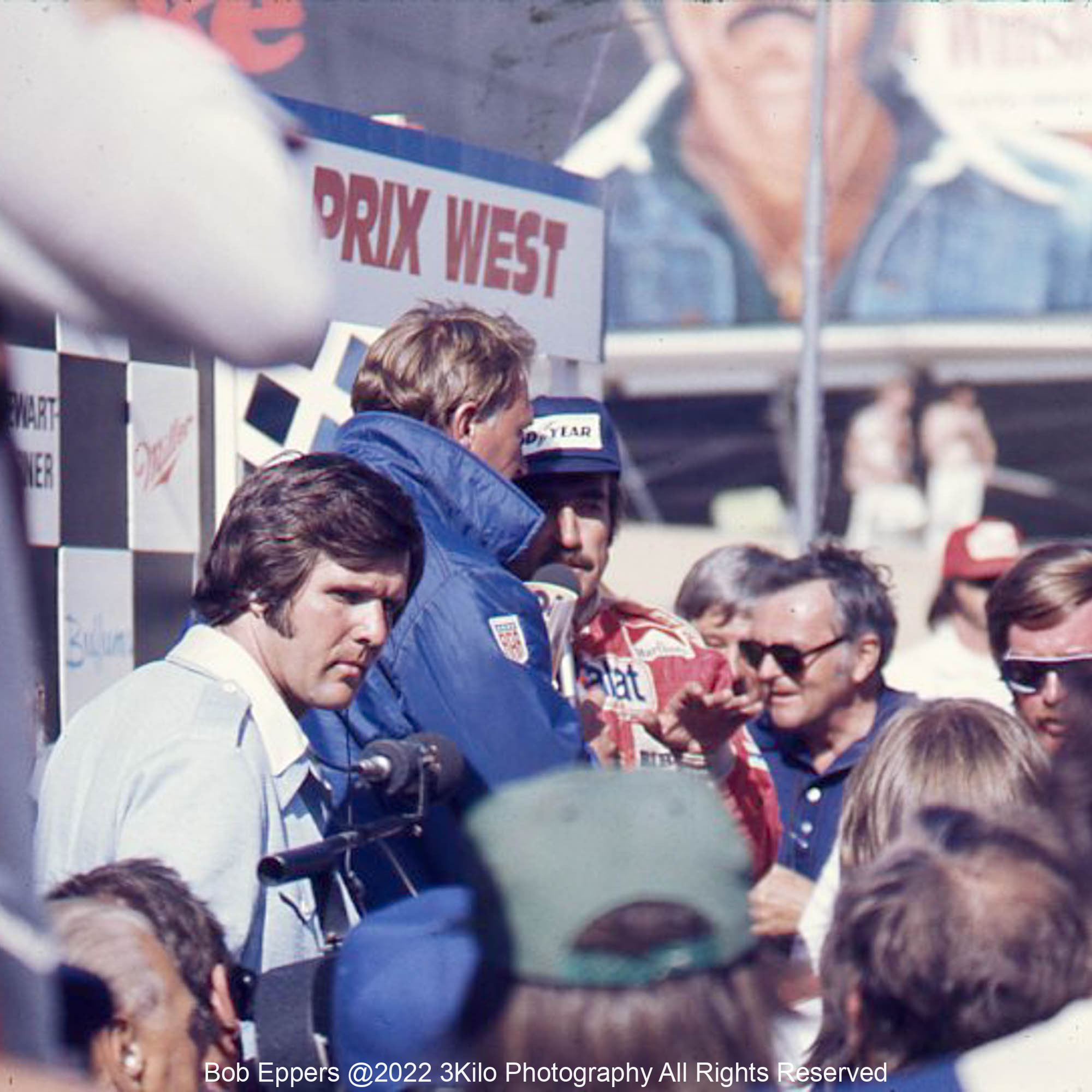 Photo of Winner Clay Regazzoni being interviewed by Dan Gurney.  1976