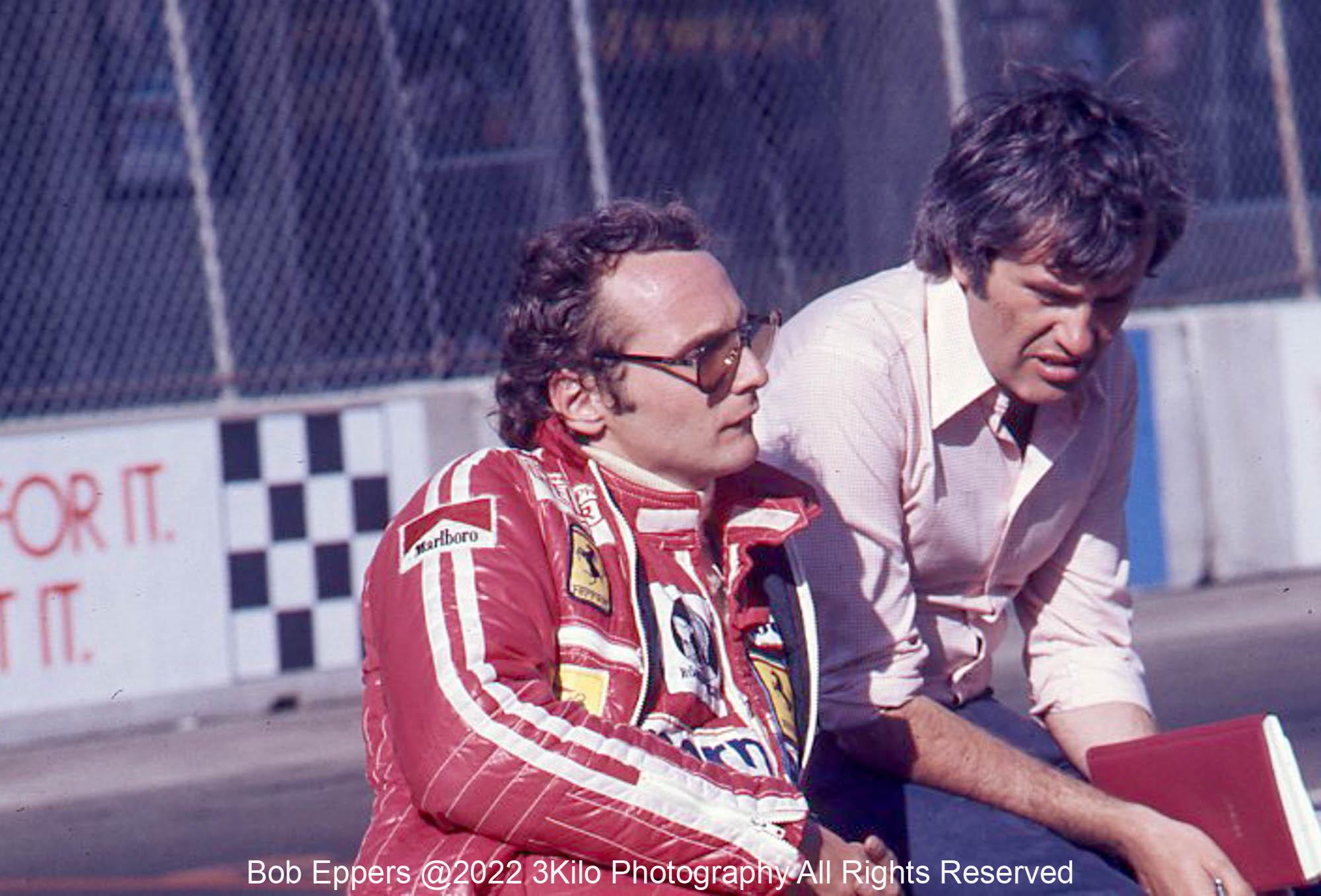 Photo of Niki Lauda in the pit lane.  1976