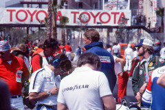 Photo of Dan Gurney in blue jacket. 1977 f1 LBGP