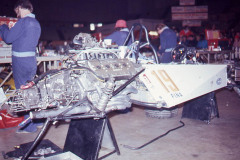 Photo of the tub snd engine of a F1 Surtees in the pit area in the Long Beach Auditorium. 1977 F1 LBGP