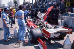 Photo of F1 Ferrari and mechanics in the pit lane.  1976