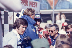 Photo of Winner Clay Regazzoni being interviewed by Dan Gurney.  1976