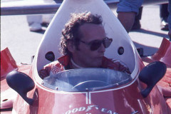 Photo of Niki Lauda in his F1 Ferrari in pit lane.  1976 F1 LBGP