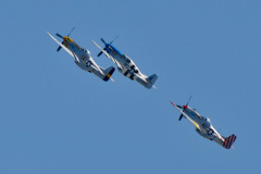 Photo of Mustang Magic at the Chino Air Show.  The unbelievable sight and sounds of 3 P-51 Mustangs doing aerobatics.