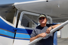 Photo of myself and my 1961 Cessna 180D